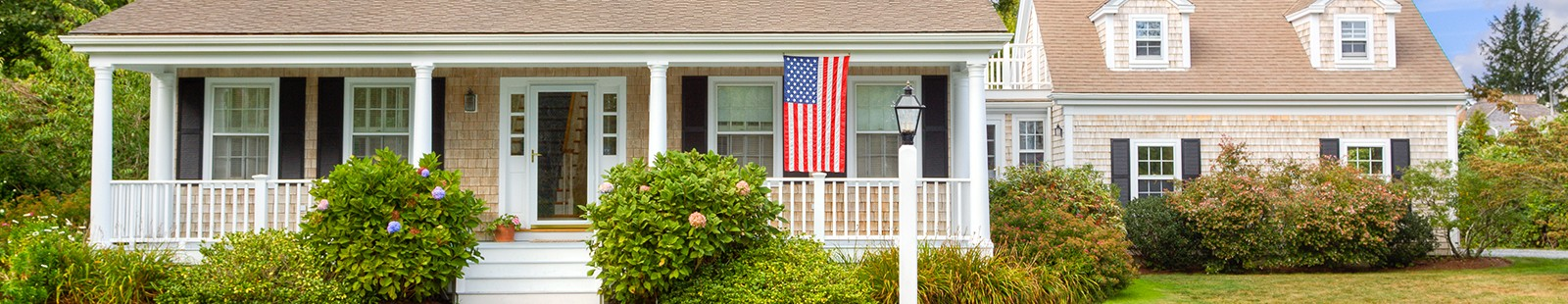 Home with American Flag hanging out front
